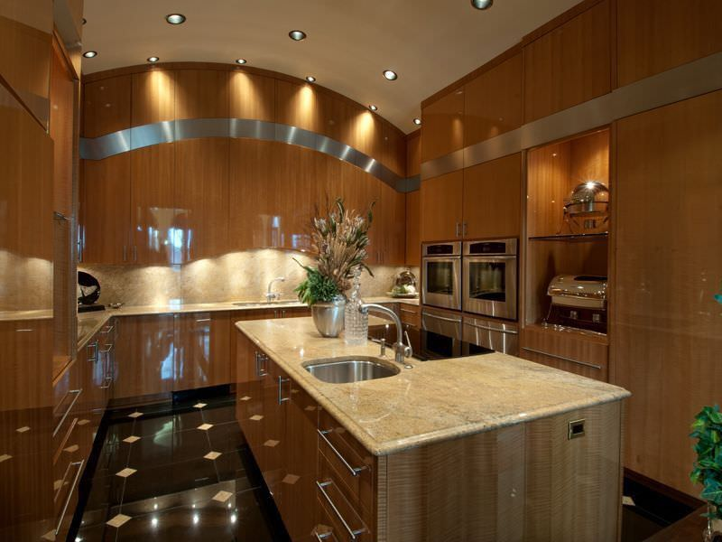 Cavernous U-shaped kitchen with arched ceiling that features two double wall ovens.