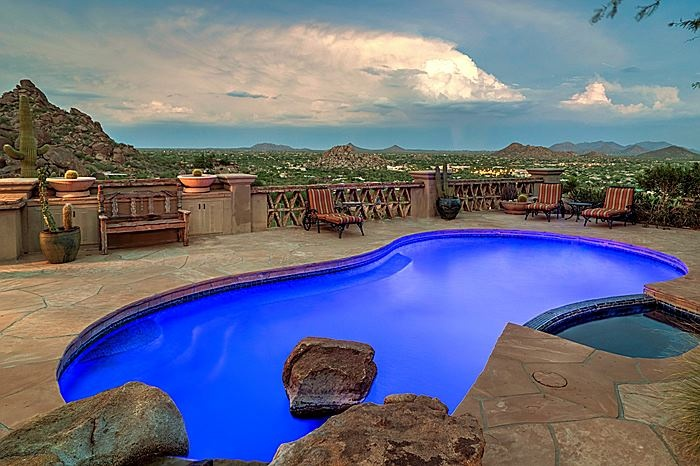 Luminescent blue water fills this kidney pool overlooking the desert