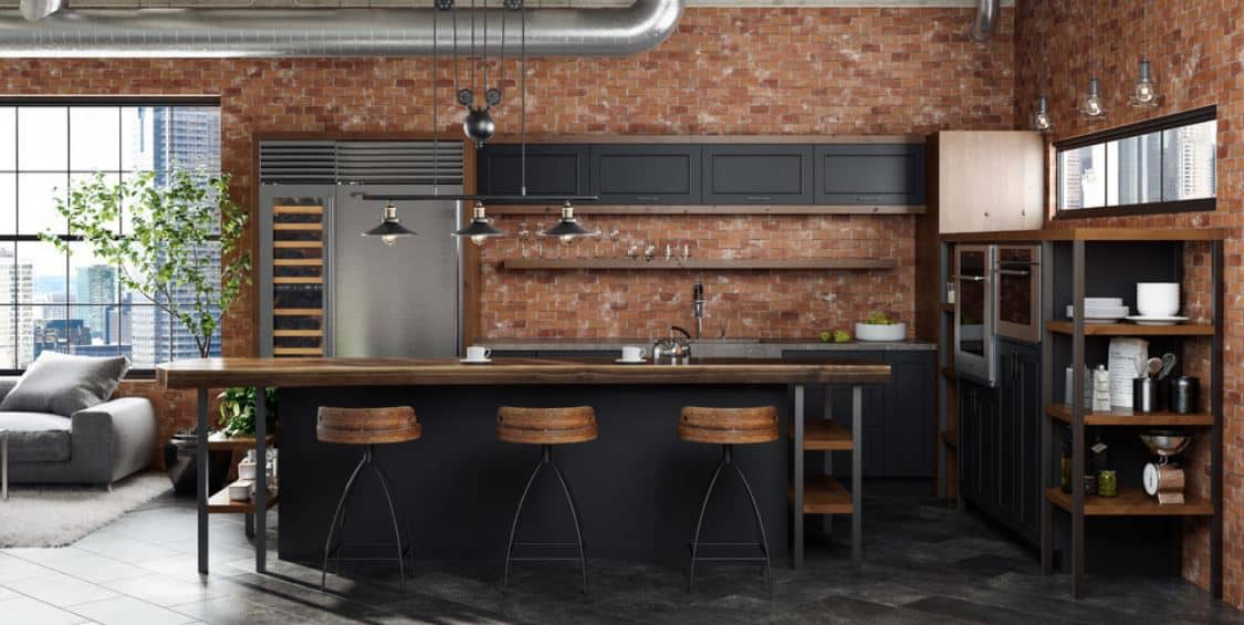 This industrial-style kitchen has a charming combination of red brick walls, black shaker cabinets and drawers and wooden elements of the countertops and shelves. This is given a nice background of gray flooring tiles and brilliant wide window.