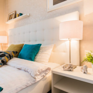 Primary bedroom with matching bedside lamps